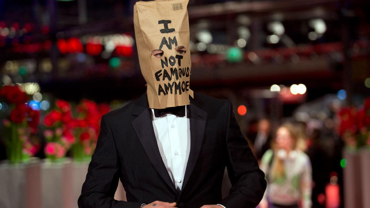 Shia Labeouf poses with paper bag