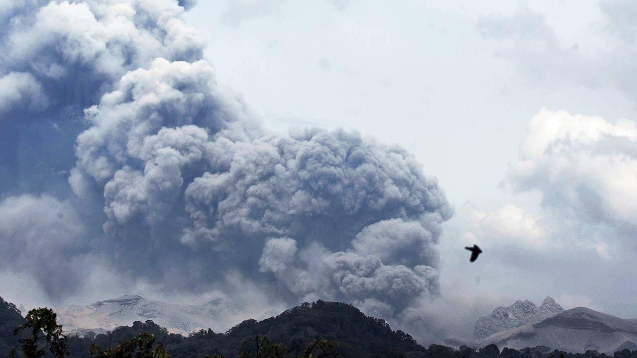 Mount Kelud erupts, as seen from Anyar village in Blitar, East Java, Indonesia, Friday, Feb. 14, 2014