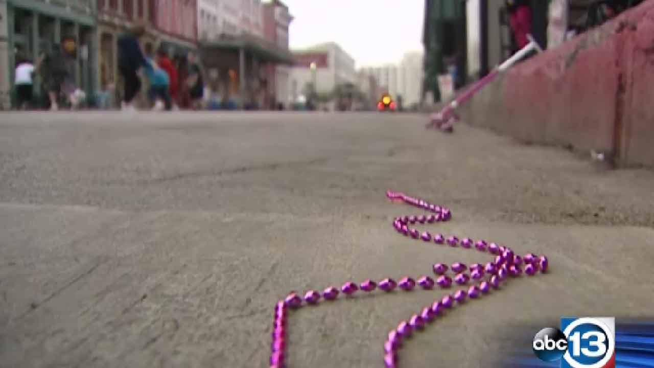 Police throw canisters of pepper-spray to subdue rowdy crowd at Galveston Mardi Gras