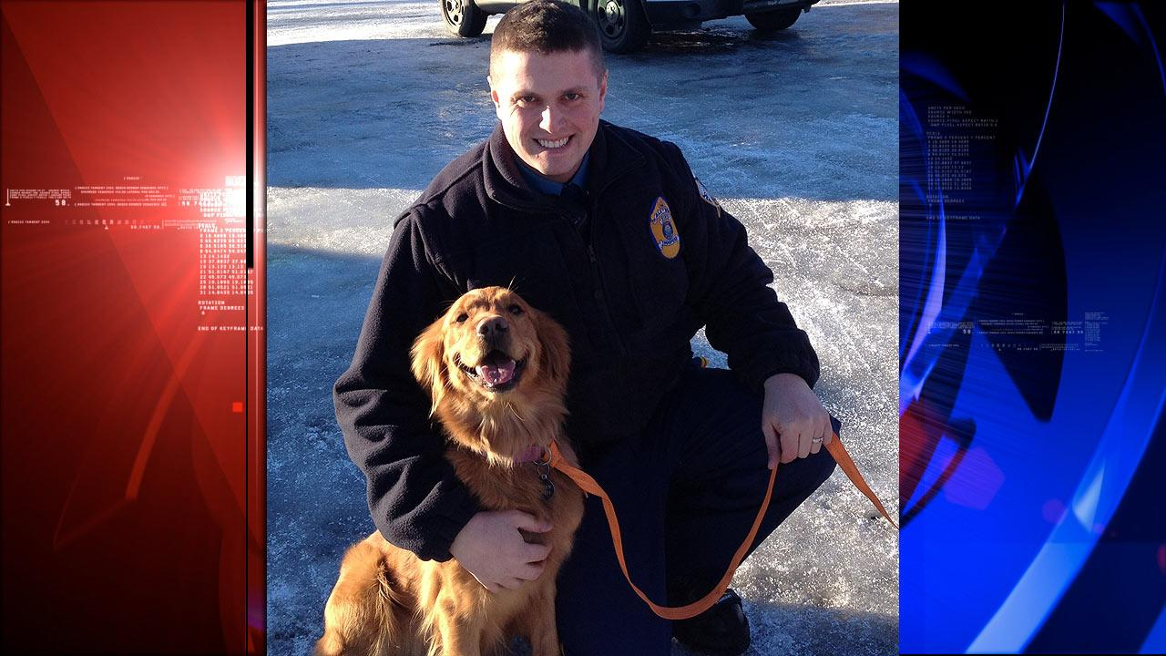 Trooper Lucas Hegg posing with his dog, Amber, a 2-year-old golden retriever