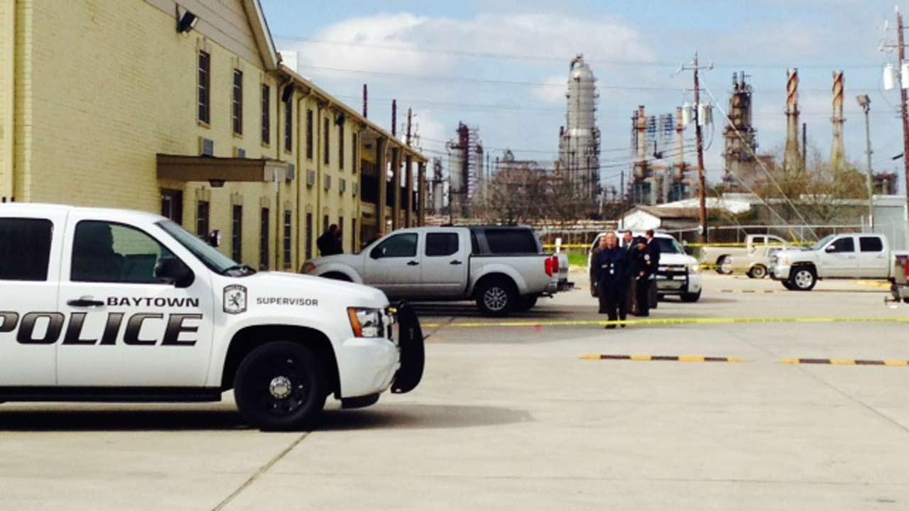 Authorities say an armed who refused to put down a shotgun was fatally shot by an officer in Baytown.