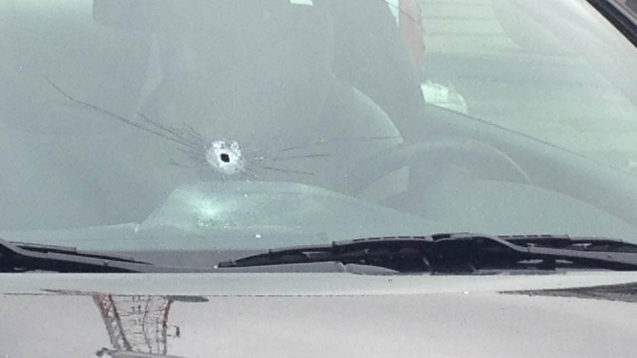 Police say a female suspect opened fire at the KTRK-TV studios and struck several cars in the parking lot.