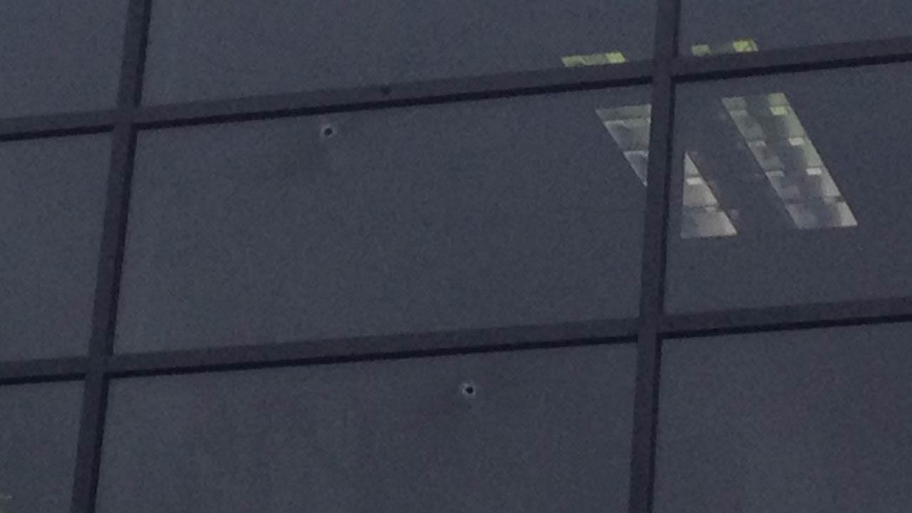 Police say a female suspect opened fire at the KTRK-TV studios, hitting several windows.