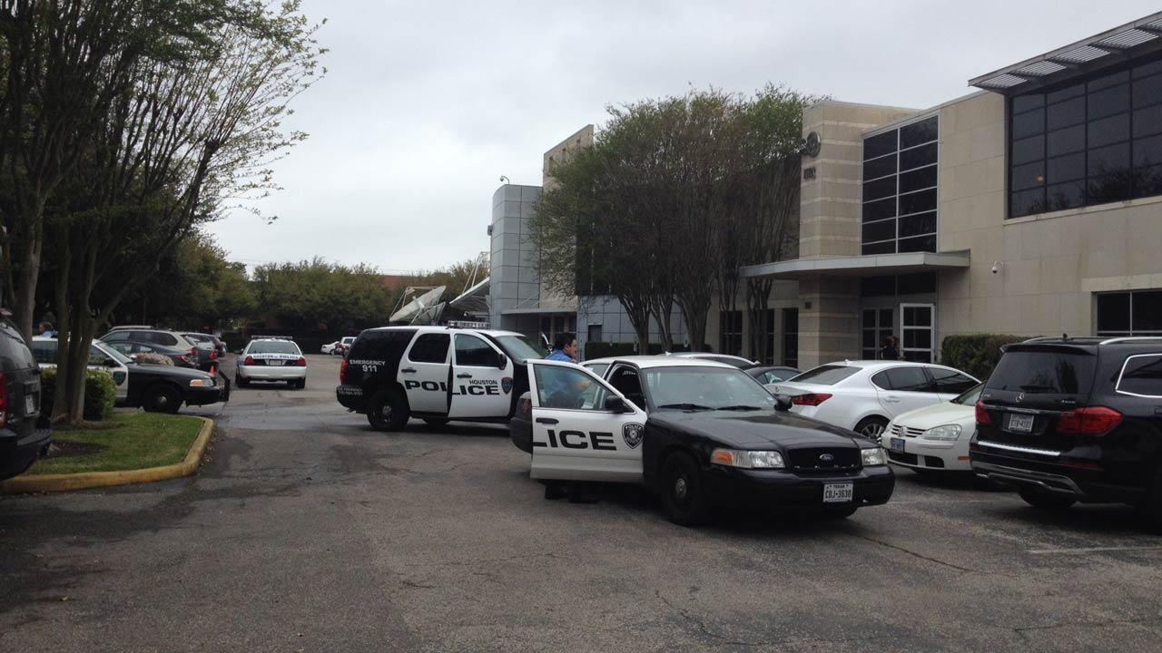 Police say a female suspect opened fire at the KTRK-TV studios, hitting several cars.