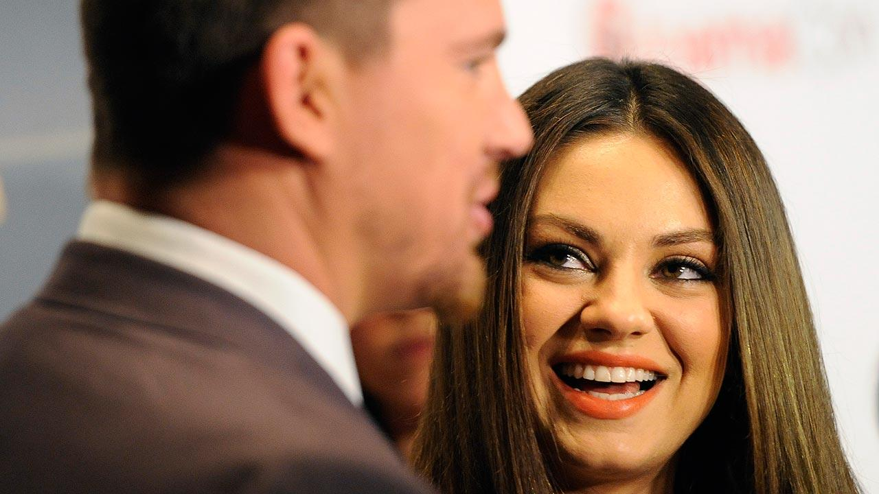 Mila Kunis, right, a cast member in the upcoming film Jupiter Ascending, looks over at fellow cast member Channing Tatum