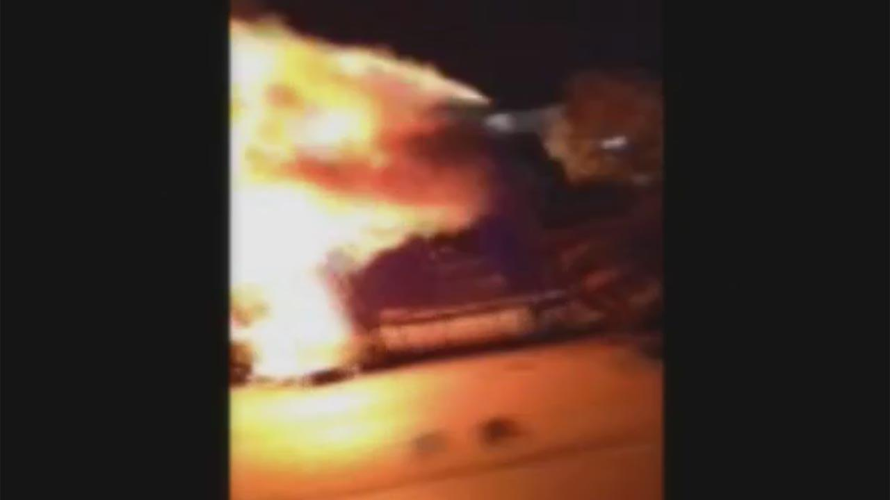 Tractor trailer bursts into flames after wreck on North Freeway