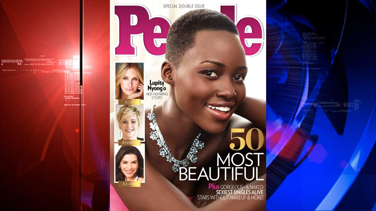 This image provided by People magazine shows the cover of its special Worlds Most Beautiful issue, featuring Lupita Nyongo. The 31-year-old actress, who won a best supporting actress Oscar for her role in 12 Years a Slave, tops the magazines list, announced Wednesday, April 23, 2014. (AP Photo/People)AP Photo