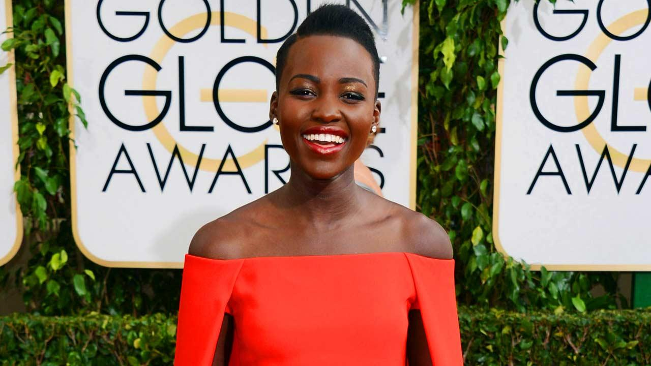 In this Jan. 12, 2014 file photo, Lupita Nyongo arrives at the 71st annual Golden Globe Awards at the Beverly Hilton Hotel, in Beverly Hills, Calif.  She topped the list of Peoples Magazine Worlds Most Beautiful list.  (Photo by Jordan Strauss/Invision/AP, File)