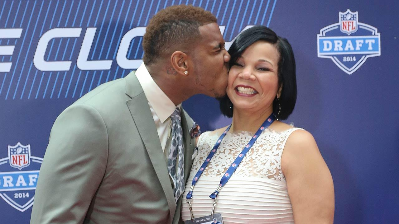 North Carolina tight end Eric Ebron kisses his mother Gina Jackson before the start of the first round of the 2014 NFL Draft