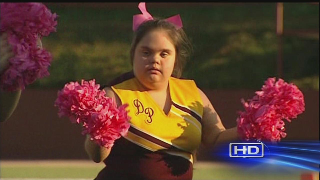 Cheerleader with Down Syndrome spreads joy at game