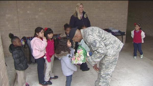 Tech sergeant surprises kids at school in time for Christmas