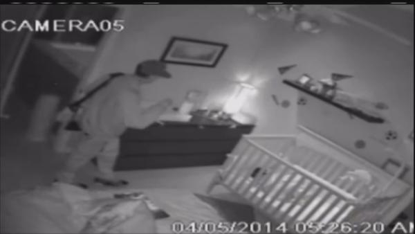 Burglary suspect watches sleeping baby
