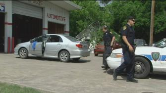 Two men shot outside auto shop