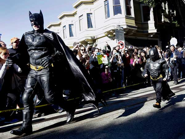 Miles Scott, dressed as Batkid, right, runs with Batman after saving a damsel in distress in San Francisco, Friday, Nov. 15, 2013. San Francisco turned into Gotham City on Friday, as city officials helped fulfill Scott&#39;s wish to be &#34;Batkid.&#34; Scott, a leukemia patient from Tulelake in far Northern California, was called into service on Friday morning by San Francisco Police Chief Greg Suhr to help fight crime, The Greater Bay Area Make-A-Wish Foundation says. <span class=meta>(AP photo)</span>