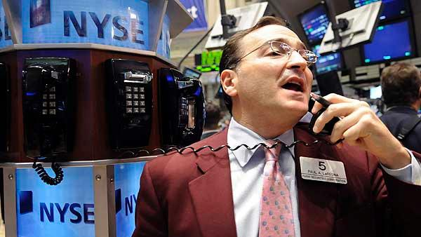 Trader Paul LaRegina works on the floor of the New York Stock Exchange Friday, Nov. 21, 2008. (AP Photo/Richard Drew)