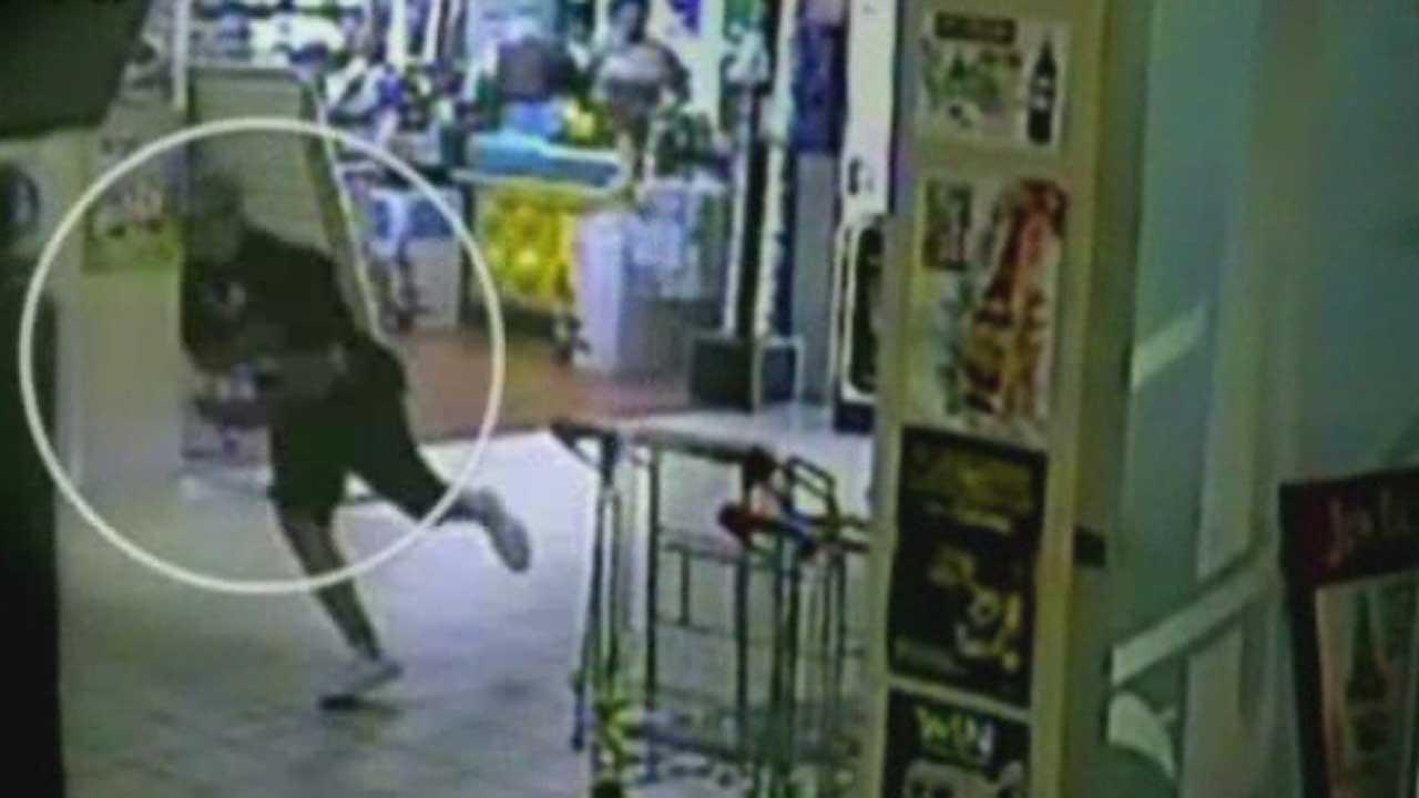Suspected purse snatcher in Australia runs into glass door