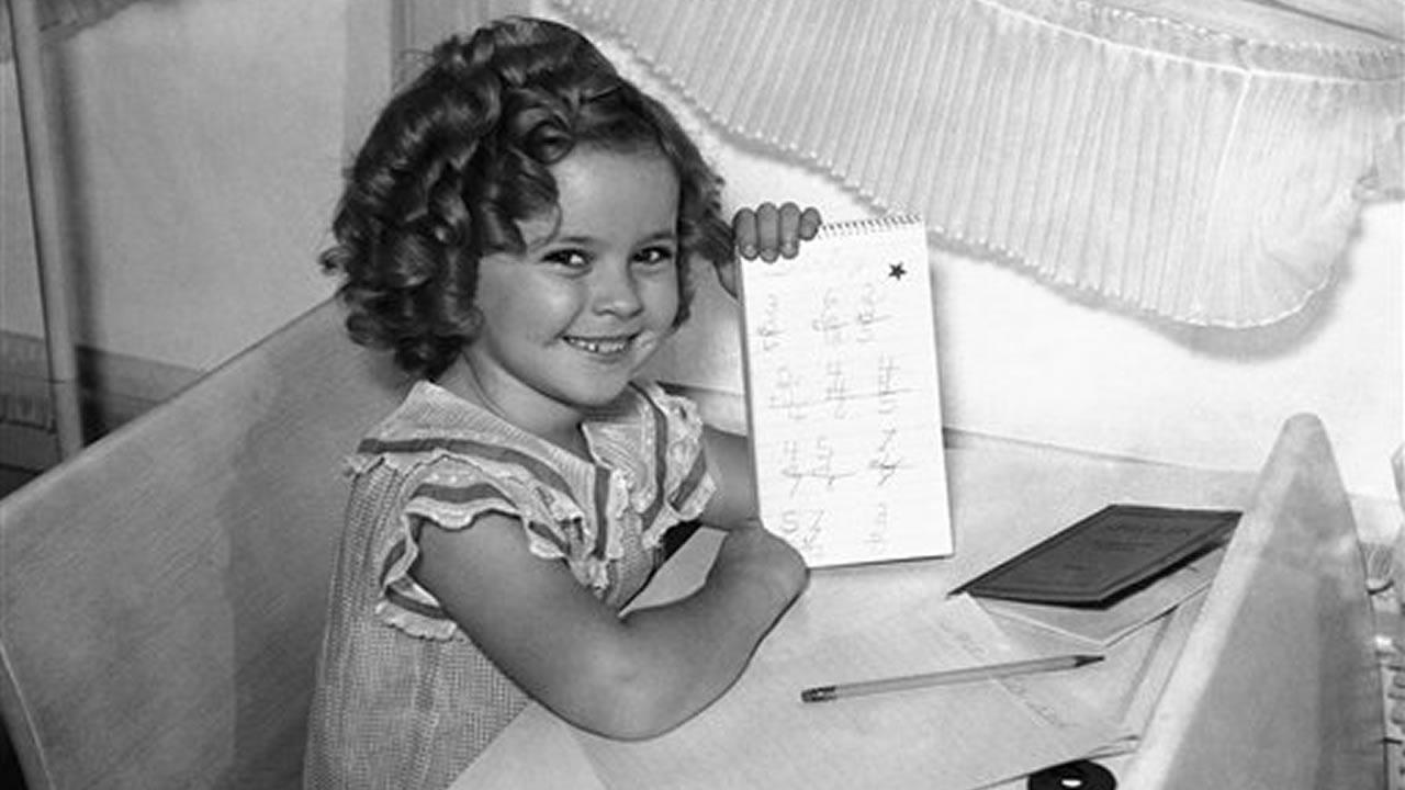 Shirley Temple, like any other little girl of 6 years, started to school and proved to be bright enough to win a gold star for her first days performance, Sept. 10, 1935, Hollywood, Calif.