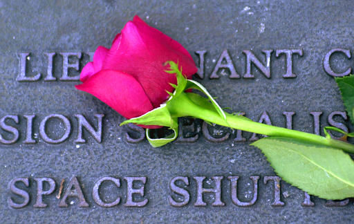 "<div class=""meta ""><span class=""caption-text "">A single rose adorns a plaque at the Challenger Memorial in Titusville, Fla., Sunday, Feb. 2, 2003. The space shuttle Columbia was torn to pieces upon re-entry to the Earth's atmosphere almost exactly 17 years after the Challenger exploded.  (AP Photo/ PETE COSGROVE)</span></div>"
