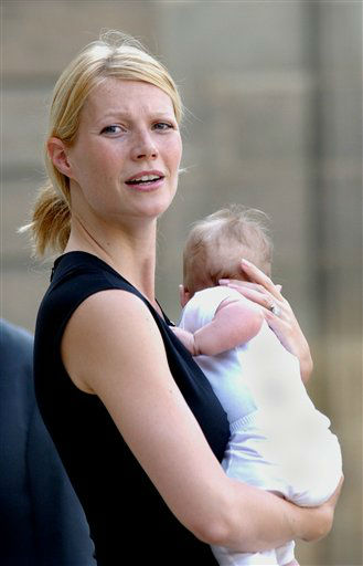 Gwyneth Paltrow holds her baby, Apple, upon her arrival at the Elysee Palace in Paris,  Sept. 5, 2004, for a ceremony to make Steven Spielberg a Knight of the Legion of Honor.  Moses Martin, Paltrow and Coldplay singer Chris Martin&#39;s second child, was born during the weekend in New York, the office of Paltrow publicist Stephen Huvane said Monday, April 10, 2006.   <span class=meta>(AP Photo&#47; JACQUES BRINON)</span>