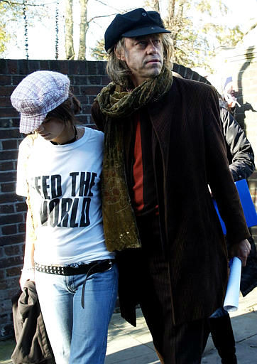"<div class=""meta image-caption""><div class=""origin-logo origin-image ""><span></span></div><span class=""caption-text"">Sir Bob Geldof arrives with his daughter Fifi Trixibell at the Air recording studios in Hampstead, London, Sunday Nov. 14, 2004, to record ""Do They Know It's Christmas"" as part of Band Aid 20, 20 years after the first version of the song raised millions for famine relief in Africa. (AP Photo/Max Nash)</span></div>"