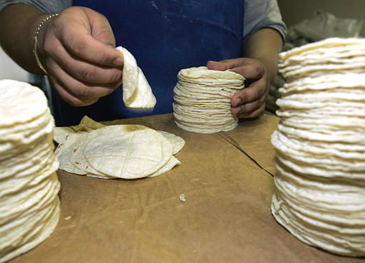 Use whole-wheat tortillas instead of white-flour tortillas  <span class=meta>(AP Photo)</span>