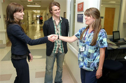 "NO. 6: MISSION VIEJO, CA -- Stars of the television show ""House,"" greet Kelly Stanley, a registered nurse at Mission Hospital in Mission Viejo, California."