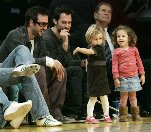 Actor David Arquette, left, looks at his daughter Coco, center, dance during a break in the action during a basketball game between the San Antonio Spurs and Los Angeles Lakers in Los Angeles Sunday, Jan. 28, 2007.  <span class=meta>(AP Photo&#47; Kevork Djansezian)</span>