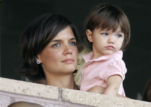 "<div class=""meta image-caption""><div class=""origin-logo origin-image ""><span></span></div><span class=""caption-text"">Katie Holmes and her daughter, Suri Cruise watch the Los Angeles Galaxy play Chelsea during a World Series of Football exhibition soccer game at the Home Depot Center on Saturday, July 21, 2007 in Carson, Calif.  (AP Photo/ Mark J. Terrill)</span></div>"