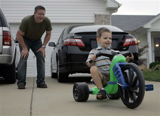 NO. 3: O&#39;FALLON, MO -- Karl Lund plays with his 3-year-old son Nathan outside their house in O&#39;Fallon, Mo.  <span class=meta>(AP Photo&#47; Jeff Roberson)</span>