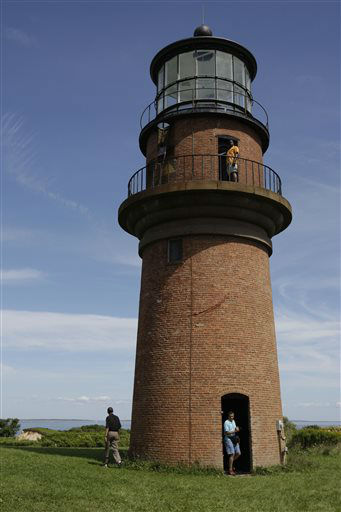 FILE - In this Aug. 27, 2009, file photo, President Barack Obama, left, walks around Gay Head Lighthouse while on vacation on Martha&#39;s Vineyard in Aquinnah, Mass. Thie lighthouse is on The National Trust for Historic Preservation 2013 list of 11 Most Endangered Historic Places. The lighthouse was the first lighthouse built on Martha?s Vineyard in Massachusetts and now is in danger of toppling over the edge of the Gay Head Cliffs. Preservationists say it?s threatened by a century of erosion at the oceanfront site and the impacts of climate change. &#40;AP Photo&#47;Alex Brandon, File&#41; <span class=meta>(AP Photo&#47; Alex Brandon)</span>