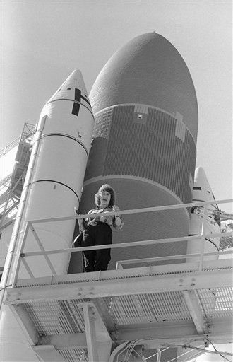 In this Oct. 29, 1985 photo, Christa McAuliffe of Concord, New Hampshire, stands next to Space Shuttle orbiter Challenger at Pad 39-A at Kennedy Space Center, Florida.  <span class=meta>(AP Photo&#47; Jim Neihouse)</span>