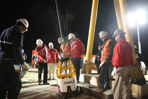 In this photo released by the Chilean government, Chile&#39;s President Sebastian Pinera, third from right, watches a descent test of the empty capsule into the rescue hole from which 33 trapped miners will be extracted one by one from the San Jose mine near Copiapo, Chile, Tuesday Oct. 12, 2010.   The first of 33 trapped miners is expected to be lifted to the surface late Tuesday after surviving more than two months below ground.  &#40;AP Photo&#47;Hugo Infante, Chilean government&#41; <span class=meta>(AP Photo&#47; Hugo Infante)</span>