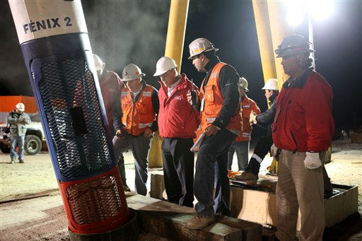 In this photo released by the Chilean government, Chile&#39;s President Sebastian Pinera, third from right, watches a test descent of the empty capsule into the rescue hole from which 33 trapped miners will be extracted one by one from the San Jose mine near Copiapo, Chile, Tuesday Oct. 12, 2010.   The first of 33 trapped miners is expected to be lifted to the surface late Tuesday after surviving more than two months below ground.  &#40;AP Photo&#47;Hugo Infante, Chilean government&#41; <span class=meta>(AP Photo&#47; Hugo Infante)</span>