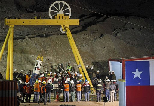 "<div class=""meta ""><span class=""caption-text "">Rescued miner Juan Andres Illanes Palma, center left,  third miner to be rescued, salutes at his arrival to the surface from the collapsed San Jose gold and copper mine where he was trapped with 32 other miners for over two months near Copiapo, Chile, Wednesday Oct. 13, 2010.at the San Jose Mine near Copiapo, Chile Wednesday, Oct. 13, 2010. At right from Illanes Palma is Chile's President Sebastian Pinera.(AP Photo/Roberto Candia) (AP Photo/ Roberto Candia)</span></div>"