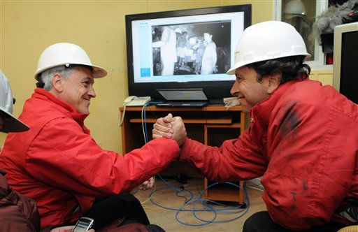 In this photo released by the Chilean presidential press office, Chile&#39;s President Sebastian Pinera, left, shakes hands his Mining Minister Laurence Golborne after watching on a monitor the arrival of rescuer Manuel Gonzalez, inside a capsule, to the trapped miners in the collapse San Jose mine, near Copiapo, Chile, Tuesday, Oct. 12, 2010. &#40;AP Photo&#47;Alex Ibanez, Chilean presidential press office&#41; <span class=meta>(AP Photo&#47; Alex Ibanez)</span>