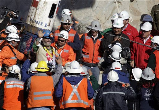 Chile&#39;s President Sebastian Pinera and Bolivia&#39;s President Evo Morales talk as rescued miner Jorge Galleguillos, left, waves while emerging from the capsule at the San Jose Mine near Copiapo, Chile Wednesday, Oct. 13, 2010. Galleguillos was the eleventh of 33 miners who was rescued from the San Jose mine after more than 2 months trapped underground. &#40;AP Photo&#47;Jorge Saenz&#41; <span class=meta>(AP Photo&#47; Jorge Saenz)</span>