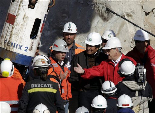 Chile&#39;s President Sebastian Pinera and Bolivia&#39;s President Evo Morales talk as rescued miner Jorge Galleguillos, not seen, arrives in a capsule at the San Jose Mine near Copiapo, Chile, Wednesday, Oct. 13, 2010. Galleguillos was the eleventh of 33 miners who was rescued from the San Jose mine after more than 2 months trapped underground. &#40;AP Photo&#47;Jorge Saenz&#41; <span class=meta>(AP Photo&#47; Jorge Saenz)</span>