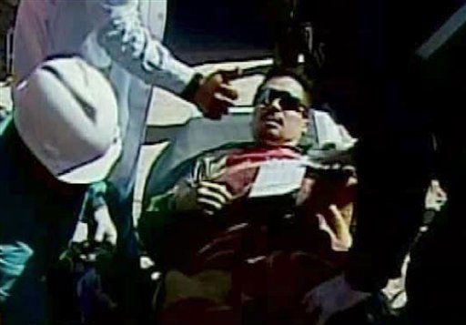 "<div class=""meta image-caption""><div class=""origin-logo origin-image ""><span></span></div><span class=""caption-text"">In this screen grab taken from video, Edison Pena, center, the twelfth miner to be rescued from the San Jose Mine near Copiapo, Chile, is shown after his rescue Wednesday, Oct. 13, 2010. (AP Photo) (AP Photo/ DG**NY** MM**NY** GM**NY**)</span></div>"