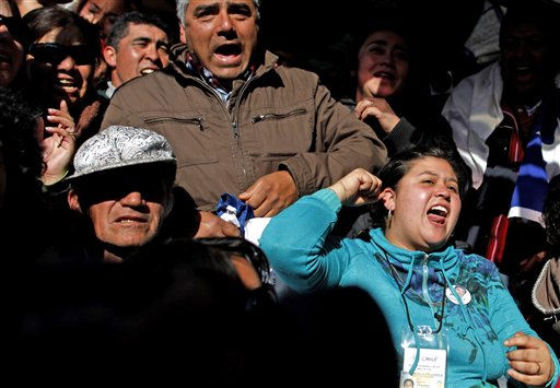 Relatives and friends of rescued miner Jorge Galleguillos celebrate while watching on a TV screen his rescue operation at the camp outside the San Jose mine near Copiapo, Chile, Wednesday Oct. 13, 2010. Galleguillos was the eleventh of 33 miners who was rescued from the San Jose mine after more than 2 months trapped underground. &#40;AP Photo&#47;Natacha Pisarenko&#41; <span class=meta>(AP Photo&#47; Natacha Pisarenko)</span>