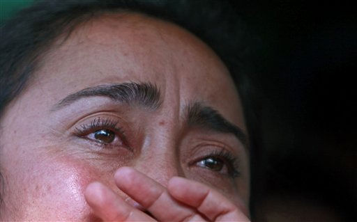 Nelly Villalobos, relative of rescued miner Jorge Galleguillos, reacts while watching on a TV screen his rescue operation at the relatives camp outside the San Jose mine near Copiapo, Chile, Wednesday Oct. 13, 2010. Galleguillos was the eleventh of 33 miners who was rescued from the San Jose mine after more than 2 months trapped underground. &#40;AP Photo&#47;Natacha Pisarenko&#41; <span class=meta>(AP Photo&#47; Natacha Pisarenko)</span>