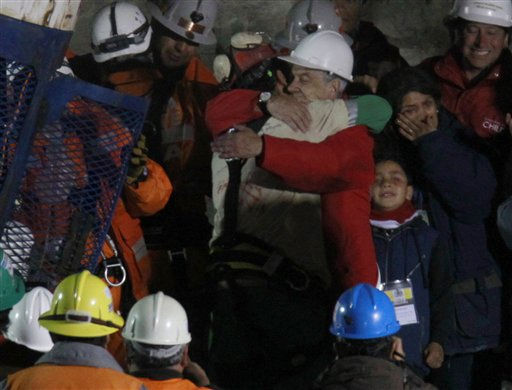 Chile&#39;s President Sebastian Pinera embraces miner Florencio Antonio Avalos Silva after he was rescued from the collapsed San Jose gold and copper mine where he was trapped with 32 other miners for over two months near Copiapo, Chile, Tuesday Oct. 12, 2010. at the San Jose Mine near Copiapo, Chile Wednesday, Oct. 13, 2010. Next to Pinera Avalos wife and daughter.&#40;AP Photo&#47;Roberto Candia&#41; <span class=meta>(AP Photo&#47; Roberto Candia)</span>
