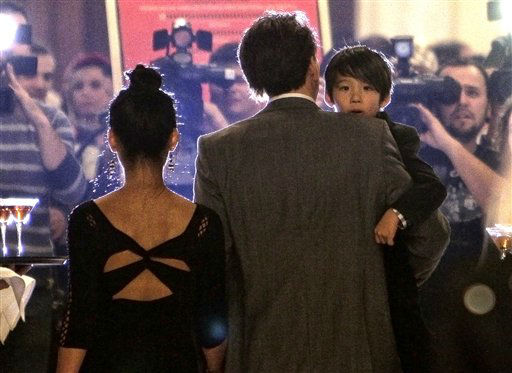 US actor Nicholas Cage, right, holds his son Kal-el as he faces media together with his wife, Alice Kim, left, at a charity event in Bucharest, Romania, Saturday night, Oct. 30, 2010. Cage is in Romania working on the movie Ghost Rider 2.  <span class=meta>(AP Photo&#47; Vadim Ghirda)</span>
