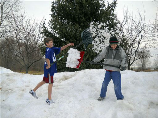 NO. 1: FISHERS, IN -- Photo courtesy of Shelley Rogers Landes shows her sons Jack Rogers, 12, left, and Maxwell Rogers, 9, as they play on a mound of snow in Fishers, Indiana. <span class=meta>(AP Photo&#47;  SCM**NY**)</span>