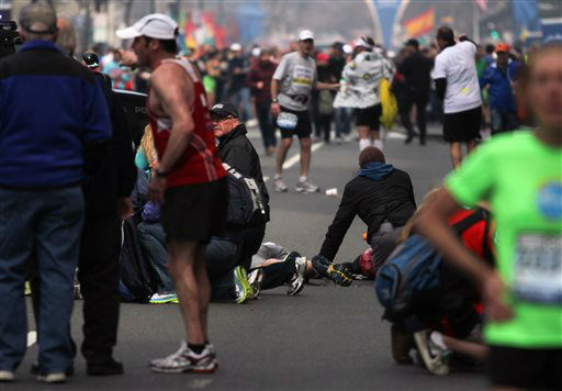 In this photo provided by The Daily Free Press and Kenshin Okubo, people react to an explosion at the 2013 Boston Marathon in Boston, Monday, April 15, 2013. Two explosions shattered the euphoria of the Boston Marathon finish line on Monday, sending authorities out on the course to carry off the injured while the stragglers were rerouted away from the smoking site of the blasts. &#40;AP Photo&#47;The Daily Free Press, Kenshin Okubo&#41; MANDATORY CREDIT <span class=meta>(AP Photo&#47; Kenshin Okubo)</span>