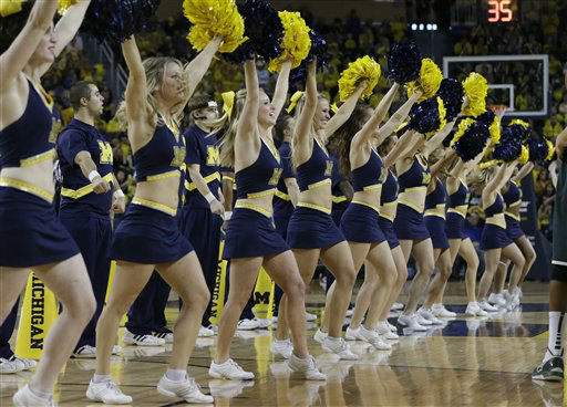 "<div class=""meta ""><span class=""caption-text "">Michigan cheerleaders perform during the second half of an NCAA college basketball game against Michigan State in Ann Arbor, Mich., Sunday, March 3, 2013. (AP Photo/Carlos Osorio) (AP Photo/ Carlos Osorio)</span></div>"