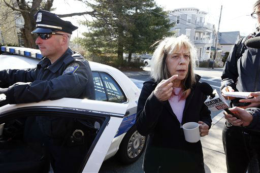Jane Sherman, right, speaks with reporters about her neighbors, the Richard family, in the Dorchester neighborhood of Boston,Tuesday, April 16, 2013. Martin Richard, 8,  was killed in Mondays bombing at the finish line of the Boston Marathon.   <span class=meta>(AP Photo&#47; Michael Dwyer)</span>
