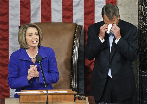 House Speaker-designate John Boehner of Ohio wipes away tears as he waits to receive the gavel from outgoing House Speaker Nancy Pelosi of Calif. during the first session of the 112th Congress, on Capitol Hill in Washington, Wednesday, Jan. 5, 2011.    <span class=meta>(AP Photo&#47; Charles Dharapak)</span>