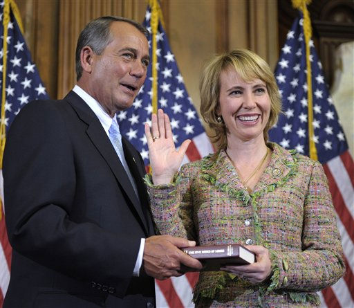 FILE - In this Jan. 5, 2011 file photo, House Speaker John Boehner reenacts the swearing in of Rep. Gabrielle Giffords, D-Ariz., on Capitol Hill in Washington. Congressional officials say Giffords has been shot in her district. &#40;AP Photo&#47;Susan Walsh, File&#41; <span class=meta>(AP Photo&#47; Susan Walsh)</span>