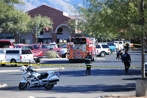 Emergency officials work at the scene of a shooting that authorities claim involved Rep. Gabrielle Giffords, D-Ariz., Saturday, Jan. 8, 2011, at a Safeway grocery store in Tucson, Ariz. &#40;AP Photo&#47;Chris Morrison&#41; <span class=meta>(AP Photo&#47; Chris Morrison)</span>