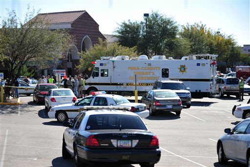 "<div class=""meta ""><span class=""caption-text "">Emergency personnel gather at the scene of a shooting involving Rep. Gabrielle Giffords, D-Ariz., Saturday, Jan. 8, 2011, at a Safeway grocery store in Tucson, Ariz.  (AP Photo/Chris Morrison) (AP Photo/ Chris Morrison)</span></div>"